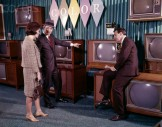 1960s Couple Man Woman Talking To Salesman In Color Television Set Sales Department